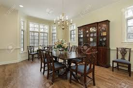 dining room in suburban home with cream colored walls stock photo