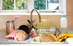 Dirty Pots And Dishes In Kitchen Sink Elevated View Stock Photo - Dirty kitchen sink