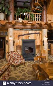fireplace in the living dining room area inside a rustic cottage