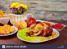 roasted chicken thanksgiving table served with decorated bright