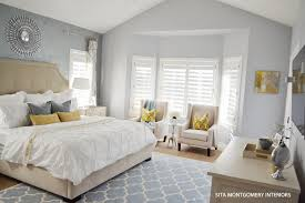 local client project reveal master bedroom sita montgomery the largest impact in this room comes from my decision to have the walls painted a soft blue gray color that compliments the faux painted wall
