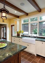 deep forest green marble countertops add gorgeous color to this