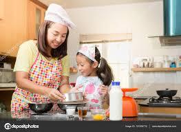 asian family enjoy making pancake in kitchen u2014 stock photo