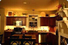 ideas for tops of kitchen cabinets kitchen cabinet decorating ideas motauto