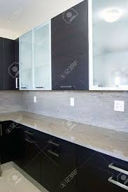 modern contemporary style wood and glass kitchen cabinets stock