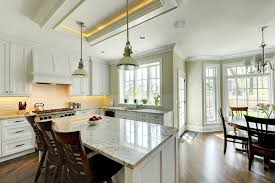 kitchen with granite countertops and wooden cabinetry light and