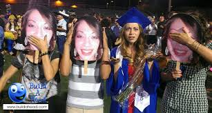 fan faces on a stick big heads for cheering at graduation celebrations are a huge hit