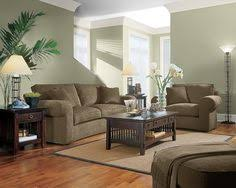 sage green living room ideas warm sage green living room with rusty orange see website for