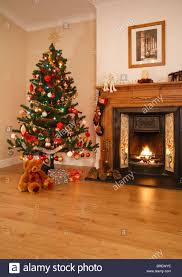 living room with open fire christmas decorations and tree