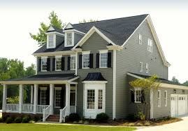 traditional transitional tudor home exterior neutral colors arched