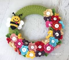 button flowers wreath button flowers and a bee adorn this