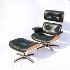 vintage eames chair in black leather w maple back ottoman selig