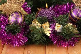 christmas composition with candles and decorations in purple