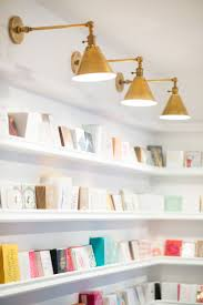 145 best lighting images on pinterest lighting ideas wall open door policy sugar paper stationer s brentwood flagship lonny featuring the boston functional library wall lights by e