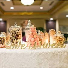 wedding dessert table displays love is sweet candy bar sign dessert table decor candy buffet