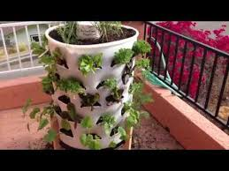 how to set up a vertical garden tower and grow your own vegetables