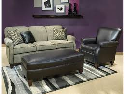 furniture black leather ottoman coffee table and beige sofa by