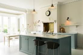 kitchen central island beautiful big windows flood this family kitchen with light the