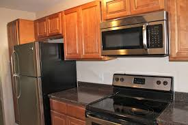 granite countertop kitchen cabinets resurfacing glass and metal