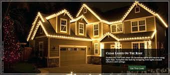 people who hang christmas lights how to hang christmas lights on roof hang lights across the roof