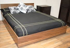 full size wood floating bed frame with charcoal coverlet and