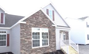 a stone or brick exterior on manufactured or modular homes you can install stone or brick facades on modular homes above is a picture of a lot model of ours with stone veneer installed on site after the home was