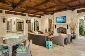 dark wood ceiling fan stone fireplace mantels patio contemporary with ceiling beams