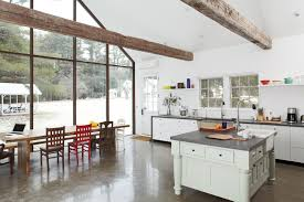 open kitchen with polished concrete floors exposed joists and a