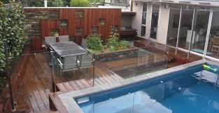 very small swimming pool deck design ideas with glass fence panels