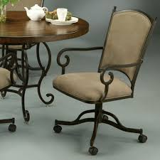 caster dining room chairs pastel atrium 5 piece caster glass dining room set in autumn rust