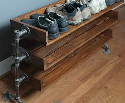 wood shoe shelves with pipe stand legs by reformedwood on etsy