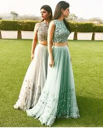 green and gold lengha guest attire for a south asian wedding