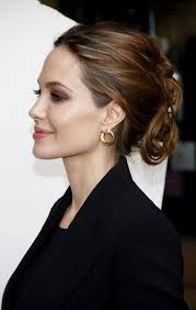 side view of pulled back hair in a bun angelina jolie simple updo