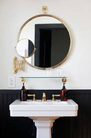 best images about bathrooms pinterest house tours modern black and brass bathroom with round mirror pedestal sink