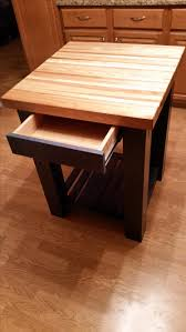 hand made knotty alder island with butcher block top by twisted