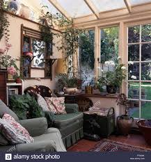 Green Armchairs Green Armchairs In Old Fashioned Conservatory Living Room With