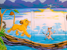 lion king mural sacredart murals close up of young simba and timon crossing the lake on a log with the sun s