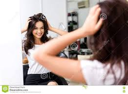 happy stylist and customer in the mirror stock photo image 78468962