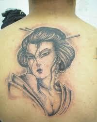 grey geisha face tattoo on man upper back