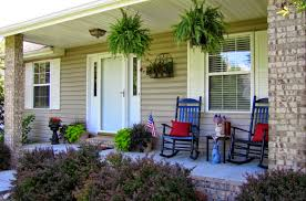 outdoor country home facade with traditional wicker furniture