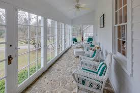 three seasons porch with removable windows that can be replaced