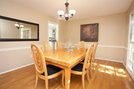 dining room a majestic dining room mirror wall in a room with