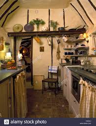 Small Cottage by Quarry Tiled Floor In Small Cottage Kitchen With Pitched Ceiling