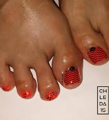 all nails painted neon orange as base big toenail with stamped