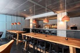 warm farang restaurant decorated with wooden furniture bar and