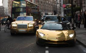 gold rolls royce gold plated mercedes bentley and lamborghini flown to london by