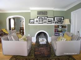 black and white photo grouping on fireplace mantel all in black