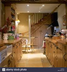 Cottage Kitchen Cupboards - simple pine doors with wrought iron handles on fitted cupboards in