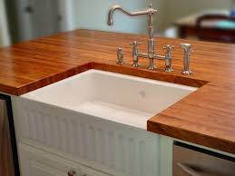 sink cutouts in custom wood countertops edge grain mesquite island top with farm sink and waterlox finish