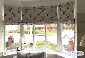 patterned roman blinds in a bay window harmony blinds of bolton